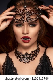 Vampire Halloween Woman. Beauty Sexy Vampire Girl portrait. Fashion Glamour Lady with fangs and red lipstick.