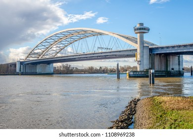 Van Brienenoord Bridge in Rotterdam over the river Nieuwe Maas seen from the north bank on the east side. The two arch bridges, part of the A16 motorway, were completed in 1965 and 1990 respectively.