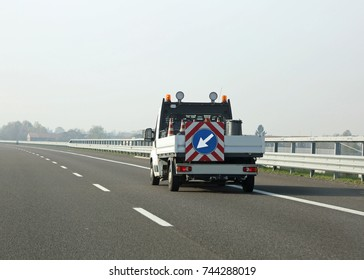 van for highway maintenance with the large arrow in the traffic signal