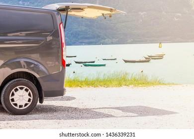 Van on the beach near at the lake