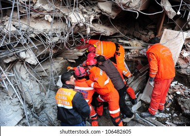 VAN, TURKEY - NOVEMBER 10, 2011: Rescue teams are searching through the buildings destroyed during the earthquake in Van. Van, Turkey. November 10, 2011