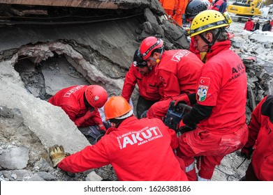 VAN, TURKEY - NOVEMBER 10: Rescue teams are searching through the buildings destroyed during the earthquake in Van on November 10, 2011 in Van, Turkey.
