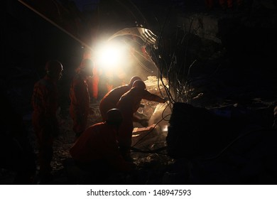 VAN, TURKEY - OCTOBER 25: Rescue team is searching for the wounded under the debris aftter the earthquake at night on October 25, 2011 in Van, Turkey. 604 killed and 4152 injured in Van Earthquake.