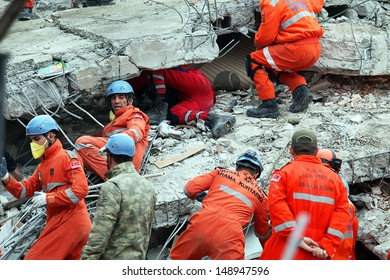 VAN, TURKEY - OCTOBER 25: Rescue team is searching for the wounded under the debris aftter the earthquake on October 25, 2011 in Van, Turkey. It is 604 killed and 4152 injured in Van Earthquake.