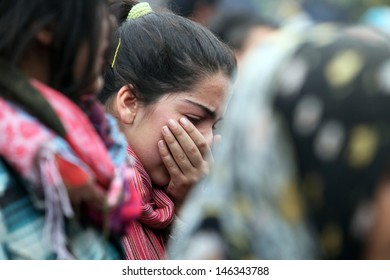 VAN, TURKEY - OCTOBER 25: Young Turkish girl crying in front of his house for own family on October 25, 2011 in Van, Turkey. It is 604 killed and 4152 injured in Van Earthquake.