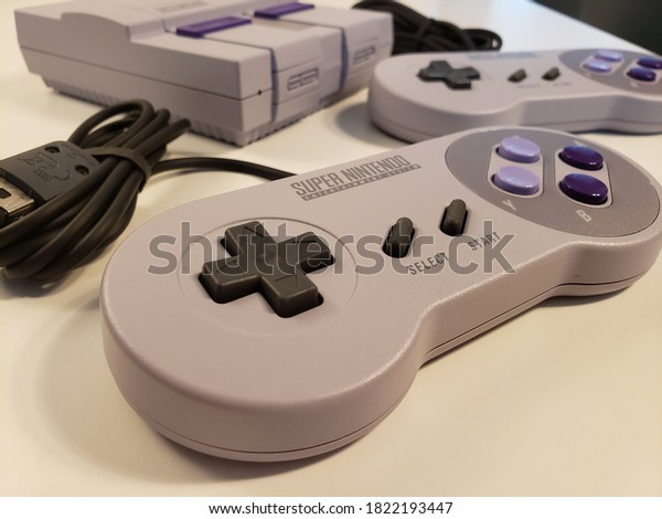 Vancocuver, BC, Canada- August 12, 2020 - Super NES Classic Eidition - game console is a home video game console system looks and feels just like the original 90s home console, except its small.