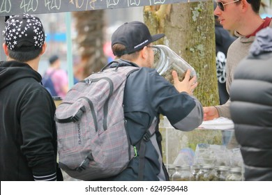 VANCOUVER - April 20,2017: A man smells a jar full of marijuana at Vancouver's annual 4-20 day on April 20, 2017.