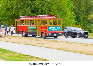 Vancouver August 2015 This is a small shuttle used by  tourists to visit the many attractions of the park  as it is really a big natural area.