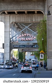 Vancouver, BC - April 20, 2015 - The entrance to Granville Island, under the south end of the Granville Street Bridge