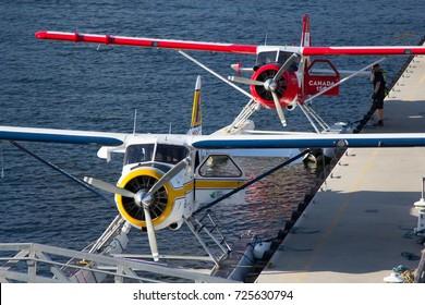 Vancouver, BC Aug 20, 2017 - Two De Havilland Beaver float planes docked at Vancouver's Harbour Airport
