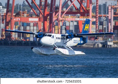 Vancouver, BC Aug 20, 2017 - A Harbour Air Twin Otter takes off from Vancouver Harbour