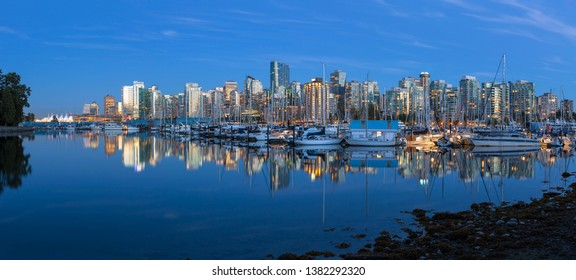 Vancouver BC British Columbia Canada marina along Coal Harbour from Stanley Park during evening blue hour