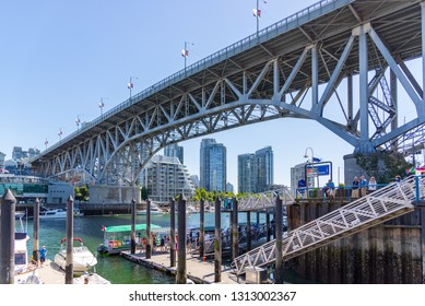 Vancouver, BC / Canada 06/15/2015 Granville Island Bridge perspective view on a summers day