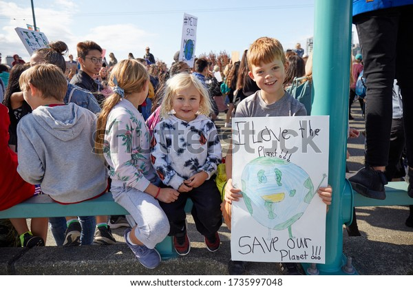 Vancouver BC, Canada 09/27/2019: Kids holding home made sign in a march of Global Climate Change strike in Vancouver.