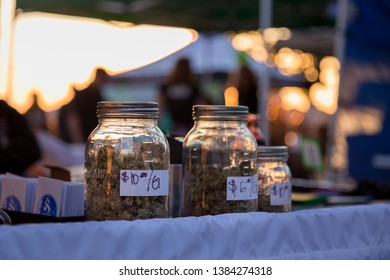 VANCOUVER, BC, CANADA - APR 20, 2019: Close-up of jars of marijuana being sold by a vendor at the 420 festival in Vancouver.