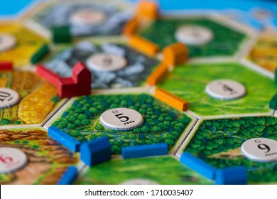 Vancouver B.C. Canada - April 12, 2020 - Settlers of Catan, a popular board game. Players are scrambling the area to get more resources and victory points.
