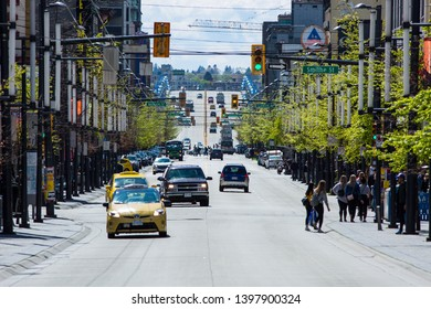 Vancouver, BC / Canada - April 27, 2019: Granville Street in downtown Vancouver looking South.