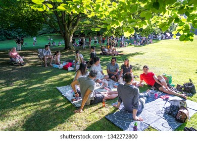 VANCOUVER, BC / CANADA – AUGUST 5, 2018: Visitors to VanDusen Botanical Gardens enjoy an afternoon outdoor concert by the Vancouver Symphony Orchestra.