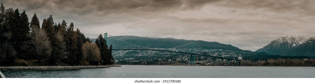 Vancouver BC Canada. February 2021, lions gates bridge and sea wall Stanley park