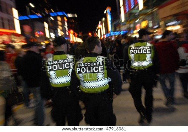 VANCOUVER, BC, CANADA - FEBRUARY 25: Police is present on every corner of every street in Vancouver during 2010 Olympic Games, February 25, 2010 in Vancouver, BC, Canada