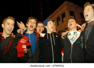 VANCOUVER, BC, CANADA - FEBRUARY 28: Canadian boys sing Canada's Anthem after Canada Hockey Team Gold Medal win at 2010 Winter Games, February 28, 2010 in Vancouver, BC, Canada