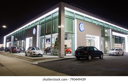 Vancouver BC, Canada - January 9, 2018: Office of official dealer Volkswagen. Volkswagen is a German automobile manufacturer specializing in high-performance and economy cars. Night shot.