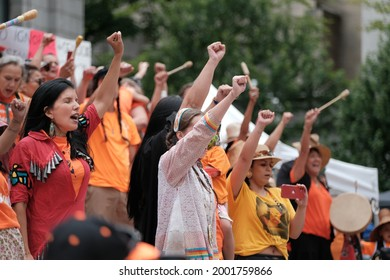 """Vancouver, BC, Canada - July 1, 2021: Vocalists perform at a """"Cancel Canada Day"""" rally in reflection of the Canadian Residential School System"""