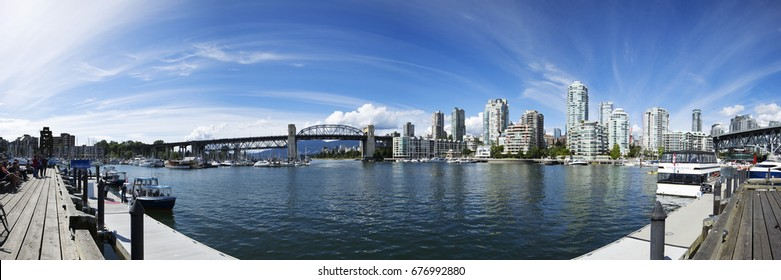 VANCOUVER BC, CANADA - July 13, 2017: Panorama of downtown Vancouver taken from Granville Island