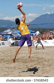 VANCOUVER, BC, CANADA - JULY 18: Men compete in beach volleyball for the 3rd place during annual Vancouver Open Tournament at Kitsilano Beach on July 18, 2010 in Vancouver, BC, Canada