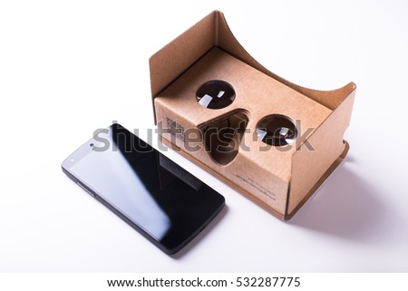 VANCOUVER, BC, CANADA - July 6, 2016: illustrative editorial composition of virtual reality headset and a smartphone by Google, assembled from pre-cut cardboard. isolated over a white