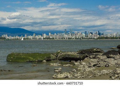 VANCOUVER BC, CANADA - JUNE 11, 2017: View of downtown Vancouver taken at low tide between Jericho Beach and Kitsilano Beach.
