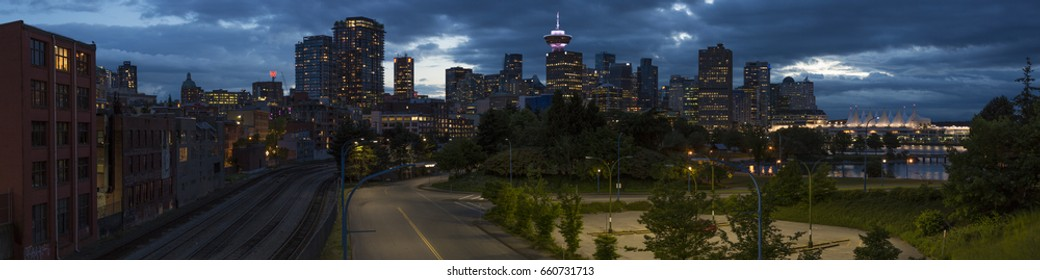 VANCOUVER BC, CANADA - JUNE 11, 2017: Panoramic view of Vancouver at night taken from the overpass to Crab park.