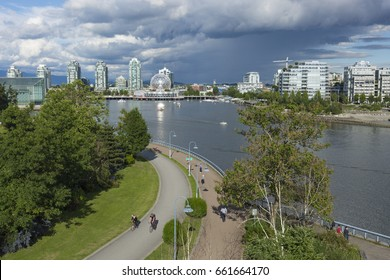 VANCOUVER BC, CANADA - June 16, 2017: Vancouver's False Creek with Science World (the geodesic dome) in the background.