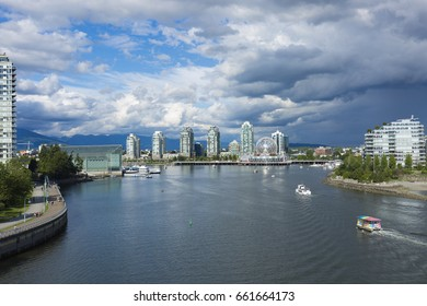 VANCOUVER BC, CANADA - June 16, 2017: Vancouver's False Creek with Science World (the geodesic dome) in the background. Exclusive to Shutterstock.