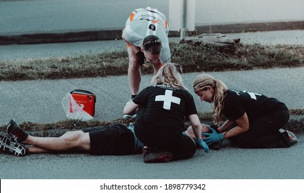 Vancouver BC Canada. June 2016. medical emergency , first aid team helping a runner accident on the street