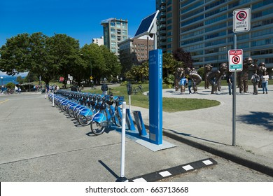 VANCOUVER BC, CANADA -  June 2017: One of many Mobi bike share stations in Vancouver. The bike share program is sponsored by Shaw Communications.