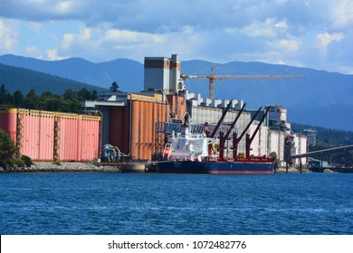 VANCOUVER BC CANADA JUNE 27 2015: Terminal grain elevators at port of North Vancouver exported approximately 11.5 million tons of a variety of grains in the Port of Vancouver.