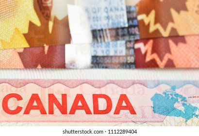 Vancouver BC, Canada - June 5, 2017 : Macro view of a Canadian visa and Canadian banknotes