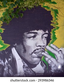 VANCOUVER BC CANADA JUNE 7 2015: Mural of Jimi Hendrix (born Johnny Allen Hendrix; November 27, 1942 â?? September 18, 1970) was an American guitarist, singer, and songwriter.