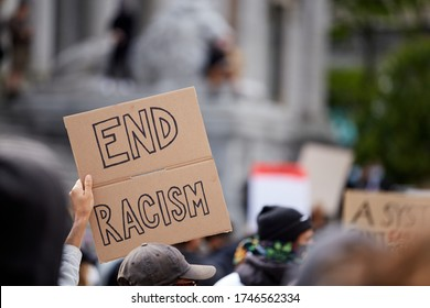 "Vancouver BC, Canada, May 31 2020: Sign ""end racism"" at the Police Violence march in Vancouver, BC"