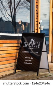 VANCOUVER, BC, CANADA - NOV 29, 2018: Signage outside a Vancouver dispensary on Kingsway Ave in the month following marijuana legalization in Canada.