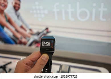 Vancouver, BC, Canada - Oct 12, 2019: A shopper takes a closer look at a Fitbit Ionic Smartwatch in a Best Buy store in Vancouver.