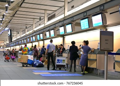 Vancouver, BC, Canada - October 13, 2017 : Motion of passengers with luggage at check in area inside YVR airport