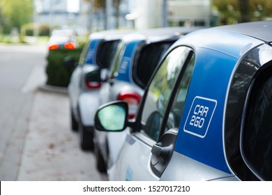 VANCOUVER, BC, CANADA - SEPT 21, 2019: A row of Car2Go SmartCars in Vancouver's Olympic Village which make up part of Vancouver's ridesharing car fleet.