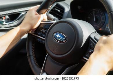 Vancouver, BC / Canada - September 27, 2020: Woman with Hands on Subaru Crosstrek Steering Wheel