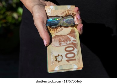 Vancouver, BC / Canada - September 8th 2018 : A Hand Holding a Bunch of Canadian Cash