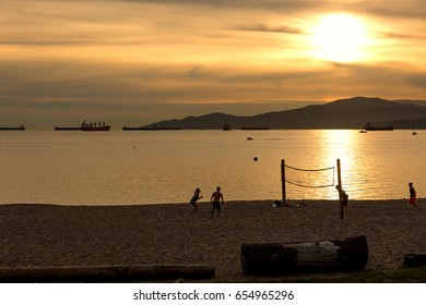 Vancouver BC, Canada:  Silhouette of players playing beach volleyball during sunset. Exclusive to Shutterstock.