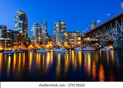 Vancouver BC Canada Skylines next to Granville Bridge along False Creek at Night. Vancouver is the third most populous metropolitan area and is the most ethnically diverse cities in Canada.