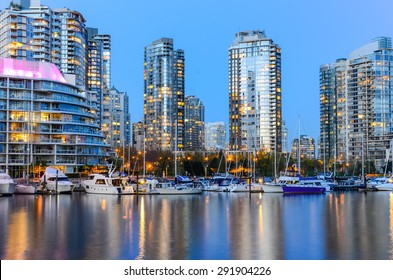 Vancouver BC Canada Skylines next to Granville Bridge along False Creek at Night. Vancouver is the third most populous metropolitan area and is the most ethnically diverse cities in Canada