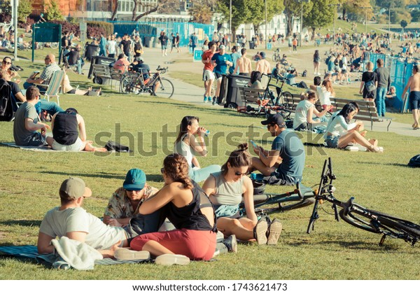 Vancouver BC Canada,April 2020.crowd of people Enjoying beach summer time at English bay beach Vancouver during the Covid_19 backgrounds